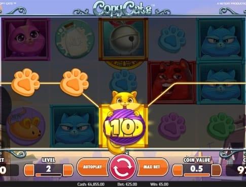 Выигрышная комбинация символов в игровом аппарате Copy Cats